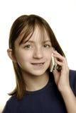 Chica joven que habla en el teléfono celular Fotos de archivo libres de regalías