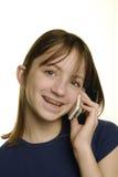 Chica joven que habla en el teléfono celular Imagen de archivo libre de regalías