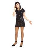 Chica joven que habla por el teléfono móvil Imágenes de archivo libres de regalías