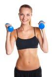 Chica joven que hace ejercicios de la aptitud Foto de archivo
