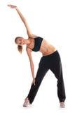 Chica joven que hace ejercicios de la aptitud Fotos de archivo