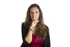 Chica joven que hace gesto del silencio Imagen de archivo