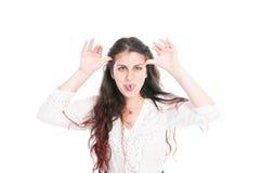 Chica joven que hace la cara divertida Imagenes de archivo