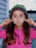 Chica joven que hace la cara torpe Foto de archivo libre de regalías