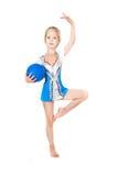 Chica joven que hace la gimnasia Imágenes de archivo libres de regalías