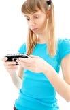Chica joven que juega al juego video Imagen de archivo libre de regalías