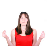 Chica joven que medita sobre el fondo blanco Imagen de archivo libre de regalías