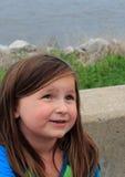Chica joven que mira para arriba Foto de archivo