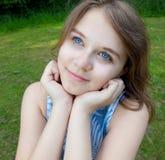 Chica joven que mira para arriba Fotografía de archivo libre de regalías