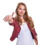 Chica joven que muestra el pulgar derecho Fotografía de archivo