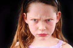 Chica joven que parece enojada Fotos de archivo libres de regalías