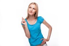 Chica joven que piensa algo encima Imagen de archivo