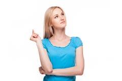 Chica joven que piensa algo encima Fotografía de archivo
