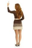 Chica joven que señala hacia arriba Fotos de archivo