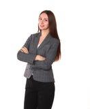 Chica joven que se coloca en un fondo blanco Imagen de archivo libre de regalías