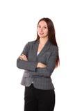 Chica joven que se coloca en un fondo blanco Foto de archivo libre de regalías
