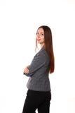 Chica joven que se coloca en un fondo blanco Fotografía de archivo libre de regalías