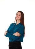Chica joven que se coloca en un fondo blanco Imágenes de archivo libres de regalías