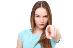 Chica joven que señala en usted - aislado en blanco Imagen de archivo