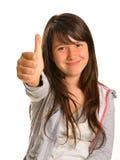 Chica joven que sonríe con los pulgares para arriba y la cara satisfecha Fotografía de archivo