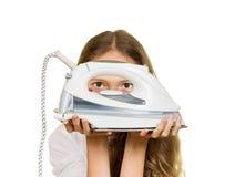 Chica joven que sostiene el hierro Fotografía de archivo libre de regalías