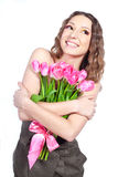 Chica joven que sostiene un ramo de flores Imagenes de archivo