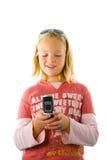 Chica joven que sostiene un teléfono celular Imagenes de archivo
