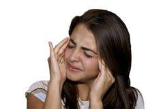 Chica joven que tiene un dolor de cabeza Foto de archivo libre de regalías