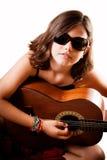 Chica joven que toca la guitarra Fotografía de archivo libre de regalías