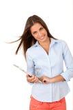 Chica joven que usa la tablilla Foto de archivo libre de regalías