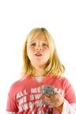 Chica joven que ve la TV Fotos de archivo