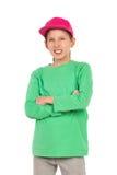 Chica joven sonriente en casquillo lleno rosado Fotografía de archivo