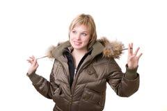 Chica joven sonriente en una chaqueta Imágenes de archivo libres de regalías