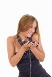Chica joven tímida con muchos collares alrededor de su cuello Fotografía de archivo libre de regalías