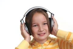 Chica joven y auriculares Foto de archivo libre de regalías