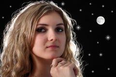 Chica joven y estrellas Foto de archivo libre de regalías