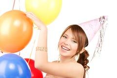 Chica marchosa con los globos Imagenes de archivo