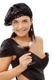 Chica marchosa feliz con el vidrio de cóctel Foto de archivo libre de regalías