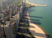 Chicago. This photograph has been taken from 94th floor of John Hancock observatory with backdrop of Michican lake and the beaches covered with shadows from stock photo