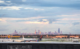 Chicago airport and skyline of the downtown. Royalty Free Stock Photo