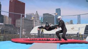 Chicago - April 30, 2015 NFL Draft. Skydiving Simulator Wind Tunnel at the `Draft Town`. The Attraction Is Called the `Sweetness Simulator` NFL Fans Fly Against stock video