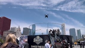 Chicago - April 30, 2015 NFL Draft. Skydiving Simulator Wind Tunnel at the `Draft Town`. The Attraction Is Called the `Sweetness Simulator` NFL Fans Fly Against stock video footage