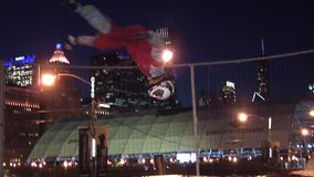 Chicago - April 30, 2015 NFL Draft. Skydiving Simulator Wind Tunnel at the `Draft Town`. The Attraction Is Called the `Sweetness Simulator` NFL Fans Fly Against stock footage