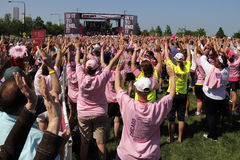 Chicago Avon Walk participants with arms up Stock Images
