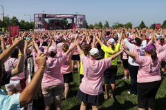 Chicago Avon Walk participants with arms up Stock Photo