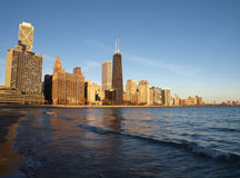 Chicago Beach Front. Chicago sandy beach front and towers in warm morning sunlight Royalty Free Stock Images