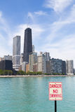 Chicago beach. Chicago skyline with no swimming area sign Stock Photography
