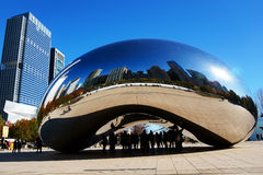 The Chicago Bean, USA. City skyline reflections in the stainless steel Cloud Gate public sculpture in Millennium Park, Chicago, Illinois, USA. The sculpture is Stock Image