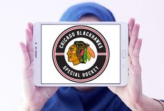 Chicago Blackhawks hockey team logo. Logo of Chicago Blackhawks hockey team on samsung tablet holded by arab muslim woman. Chicago Blackhawks are a professional royalty free stock images