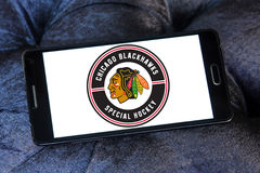 Chicago Blackhawks hockey team logo. Logo of Chicago Blackhawks hockey team on samsung mobile. Chicago Blackhawks are a professional ice hockey team in NHL based stock images